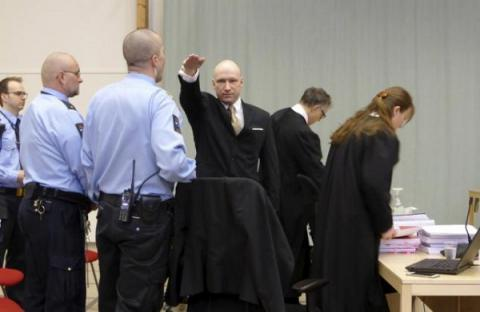 Mass killer Breivik makes Nazi salute as he sues Norway for 'inhuman treatment'