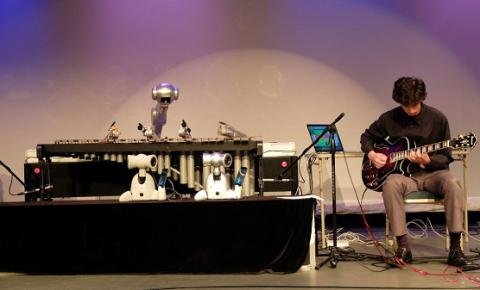 A four-armed robot can now improvise music as well as human bandmates