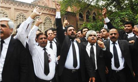 Pakistani lawyers at strike after dozens killed in suicide bombing