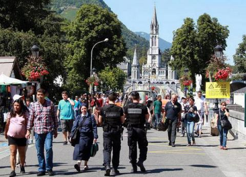 Catholic pilgrims visit Lourdes shrine in France under all-time heavy security