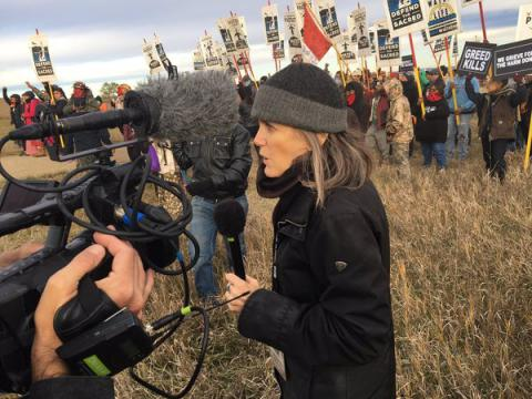 "U.S. journalist charged in ""riot"" for covering North Dakota protests"
