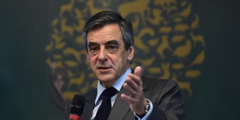 French Fillon charged but still in race