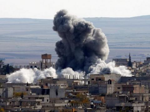 33 people killed in airstrike that hit school building near IS-held Raqqa - Syrian Observatory