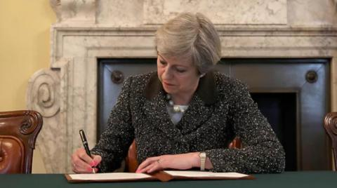 UK PM signs letter to to European Council on Brexit start