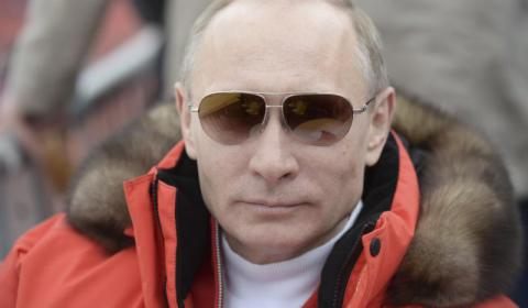 Putin says climate change not caused by emissions