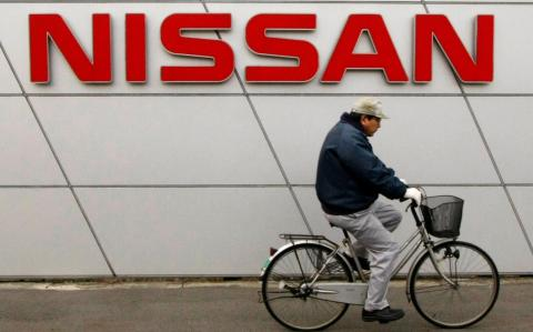 Nissan boss says quality scandal 'undermined trust' as car maker cuts profit forecast