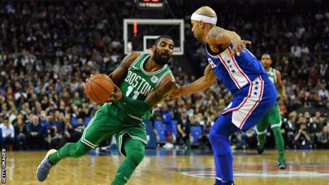 b05019dc8528 NBA  Boston Celtics beat Philadelphia 76ers at London s O2 Arena. Boston s  Kyrie Irving ...