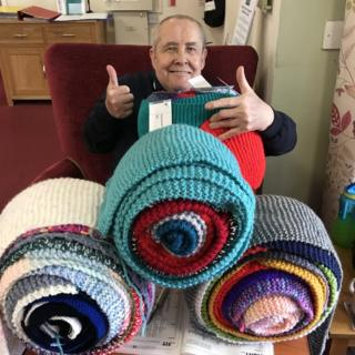 Carmarthen care home residents wrap scarf around their home