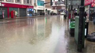 Burst pipe floods south London high street