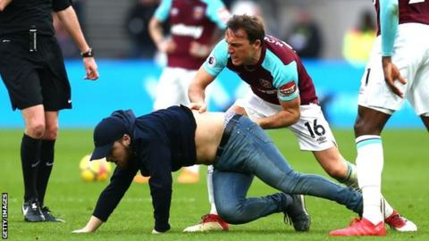 Fans approach players during West Ham's defeat by Burnley at London Stadium