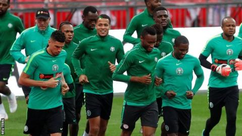 England v Nigeria: Visiting players relax by singing at the piano before friendly