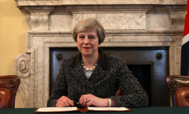 May names term of final completion of Brexit agreement with EU members