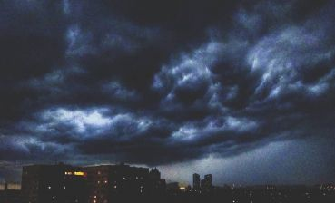 Heavy downpour and thunderstorm in Kyiv, - video
