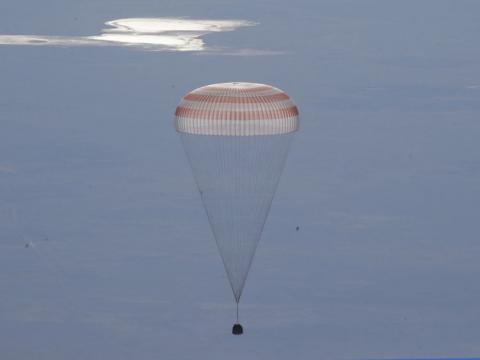 Astronauts return to Earth after 2,600 orbits