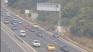 Driver who left car on M1