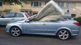 Police stop driver with mattress stuffed in car