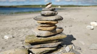 Beaches 'spoiled': Should rock stacking be banned?