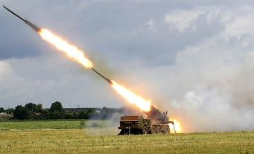 Ukrainian soldiers check readiness of BM-27 Uragan