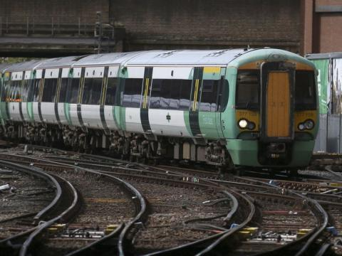 Grayling criticised over rail fares and pay