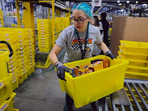 An economist explains how Amazon could use its lobbying for a $15 minimum wage as a 'weapon' against other retailers (AMZN)