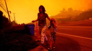 In pictures: Malibu fire rages through coastal homes