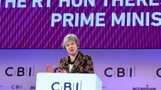 PM cheered at CBI for vision beyond Brexit