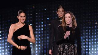 Meghan presents award to her wedding dress designer