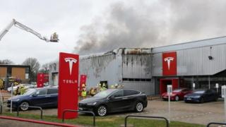 Fifty firefighters at Tesla showroom fire