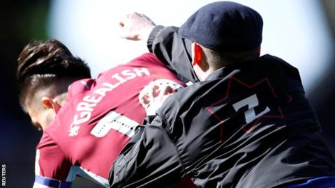 Footballer attacked on pitch by spectator