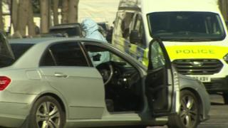 Police open fire after car 'driven at officers' in London