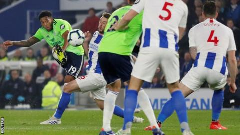 Cardiff cut gap with vital win at Brighton in relegation scrap