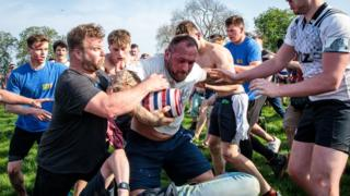 Hallaton Bottle Kicking: Villages compete in bruising tradition