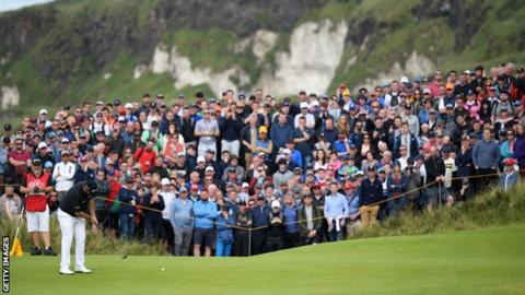 Lowry leads The Open by four shots after sensational course-record 63