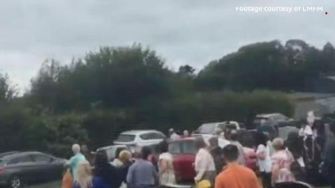 Car drives at crowd in Dundalk graveyard