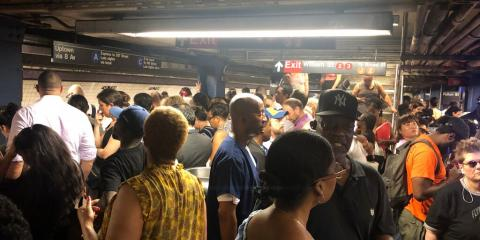 New York's subway system flooded yet again torrential rain, leaving commuters soaking wet and furious
