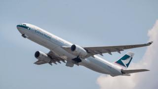 Cathay threatens to fire staff over