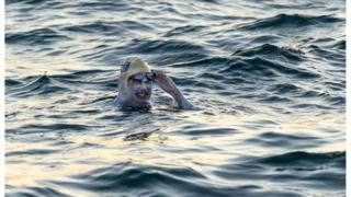 Sarah Thomas: Woman first to swim Channel four times non-stop