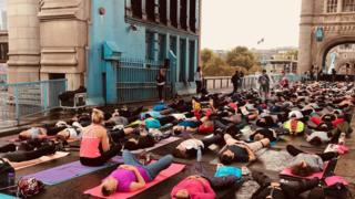 London Car Free Day: Tower Bridge shuts for mass yoga session