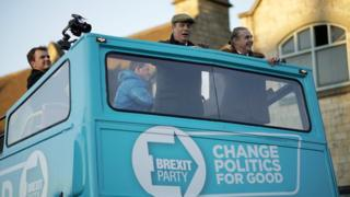 Three MEPs quit Brexit Party to back PM