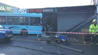 Sheffield school bus crashes into barbers shop