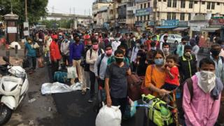 India coronavirus: Huge crowds as train services resume