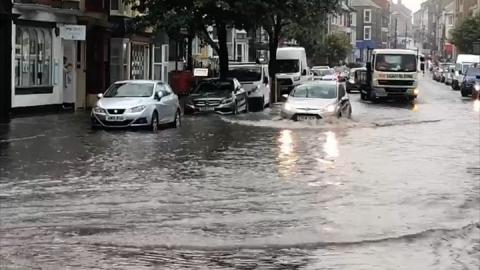 Power cuts and flash flooding in parts of Wales